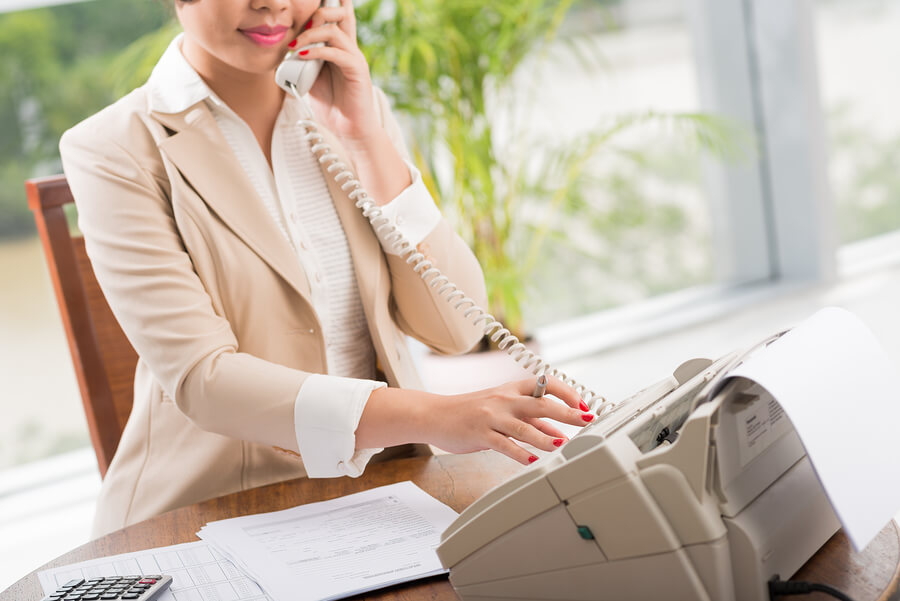Finance woman receiving fax
