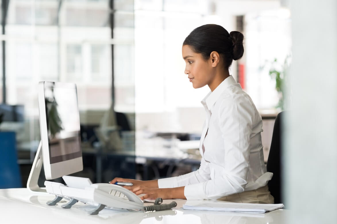 Professional Women Working On Desktop at Her Modern Desk